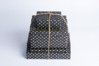 gold dots on black paper gift wrap