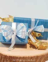 up-close-view-of-blue-fall-themed-gift-wrap-download-freebie-by-pretty present-blog