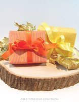 up-close-view-of-orange-and-yellow-fall-themed-gift-wrap-download-by-pretty present